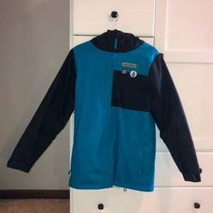Blue and black Volcom snowboarding jacket